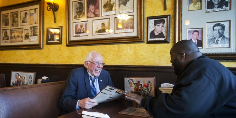 Democratic presidential candidate Sen. Bernie Sanders, I-Vt. left, sits with rapper Killer Mike at The Busy Bee Cafe Monday, Nov. 23, 2015, in Atlanta. Killer Mike is scheduled to introduce Sanders at a campaign event at the Fox Theatre later in the evening. (AP Photo/David Goldman)